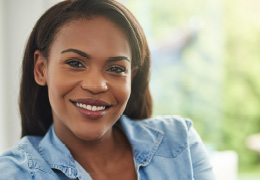 Young african american woman looking confident with smile on face